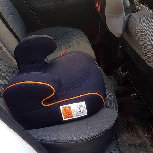 صندلی بوستر کودک سورمه ای با نوار نارنجی